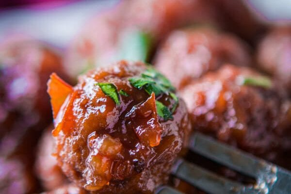 Raise your hand if your mom used to make Chili Sauce and Grape Jelly Slow Cooker Meatballs! Mine did too but I'd forgotten about them until now! ohsweetbasil.com