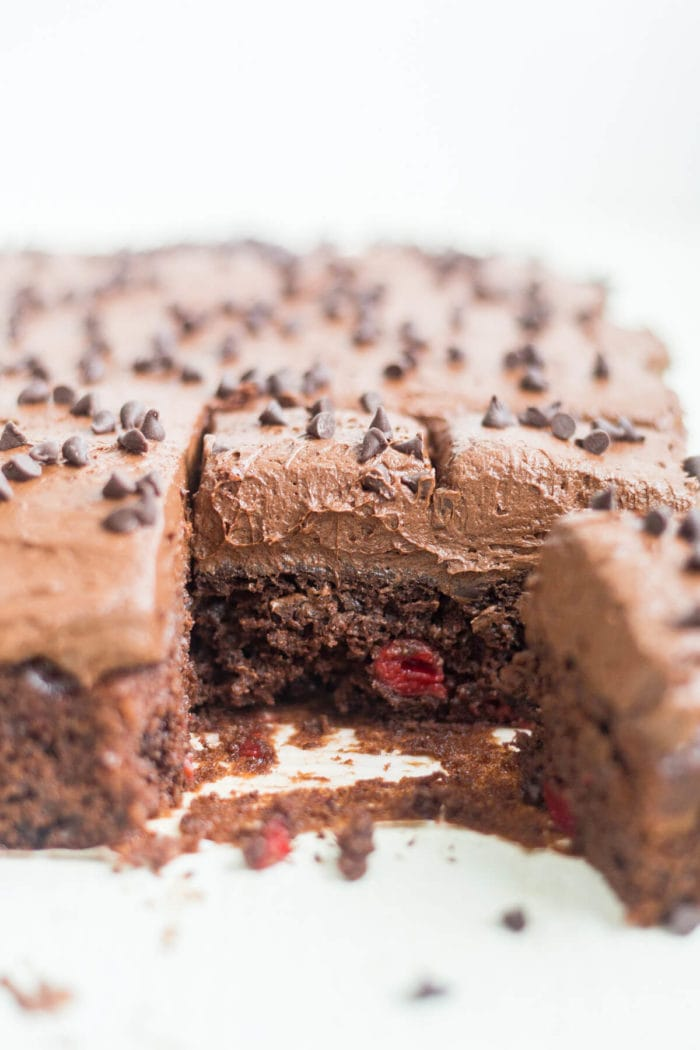 easy chocolate cake with cherry pie filling, sliced in baking dish