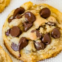 A photo of a chocolate chip pudding cookie covered in chocolate chips.