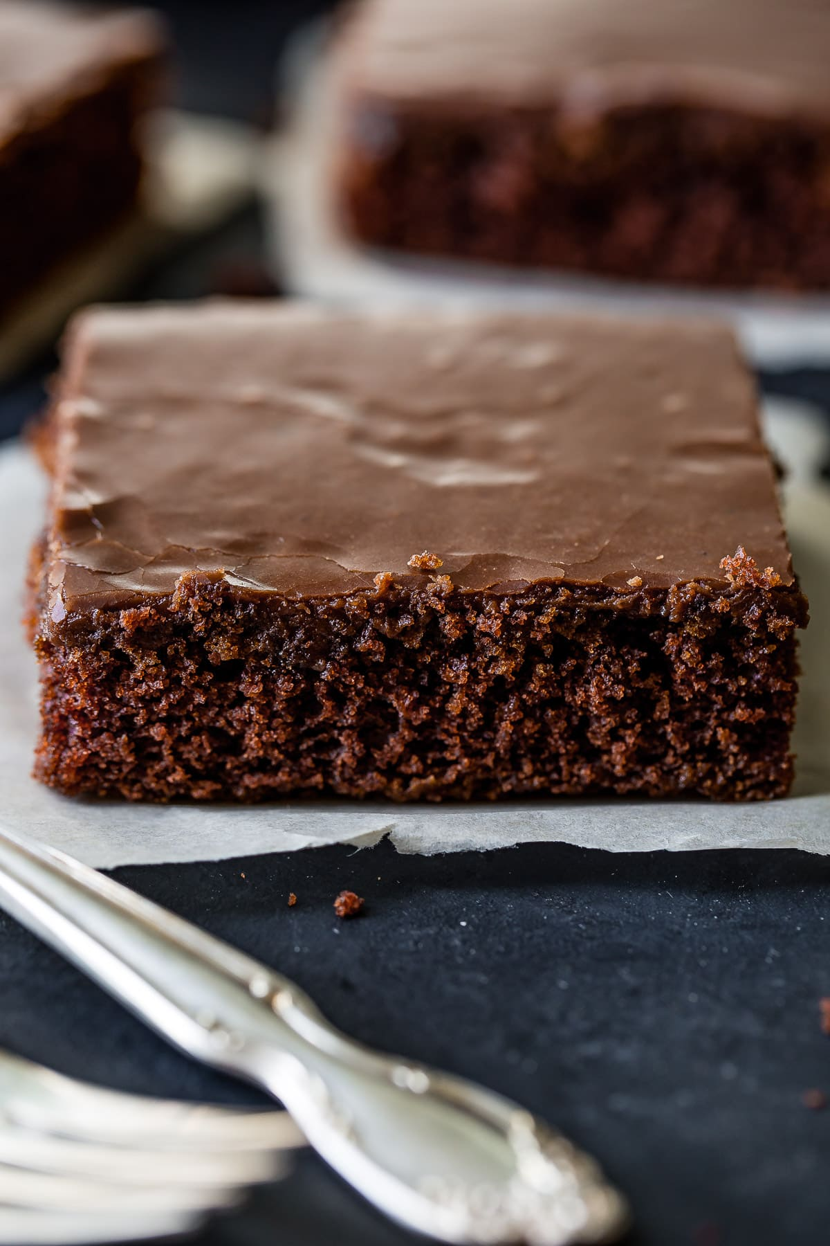 My mom's chocolate sheet cake is probably the classic chocolate sheet cake recipe you grew up with, but in case you lost it, here it is along with a cooked chocolate frosting!  ohsweetbasil.com
