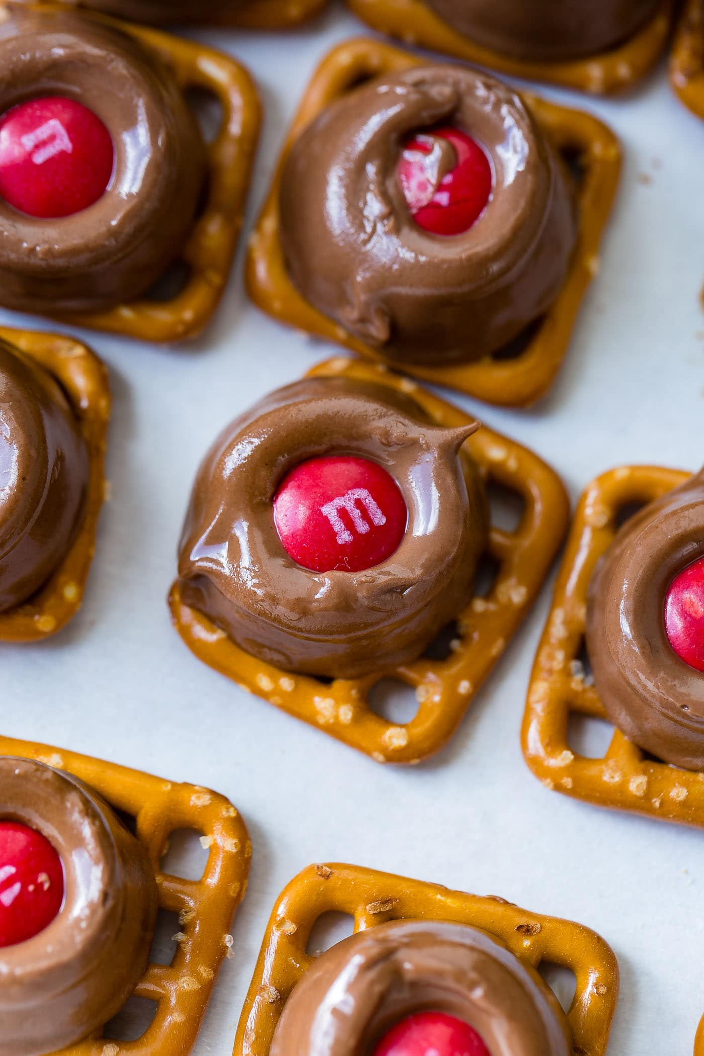 a platter with rolo pretzels topped with red and green m&ms