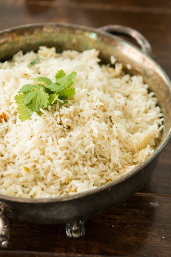 This copycat cilantro lime rice is just like Cafe Rio's and it makes the perfect addition to any Mexican dish or entree for dinner. ohsweetbasil.com