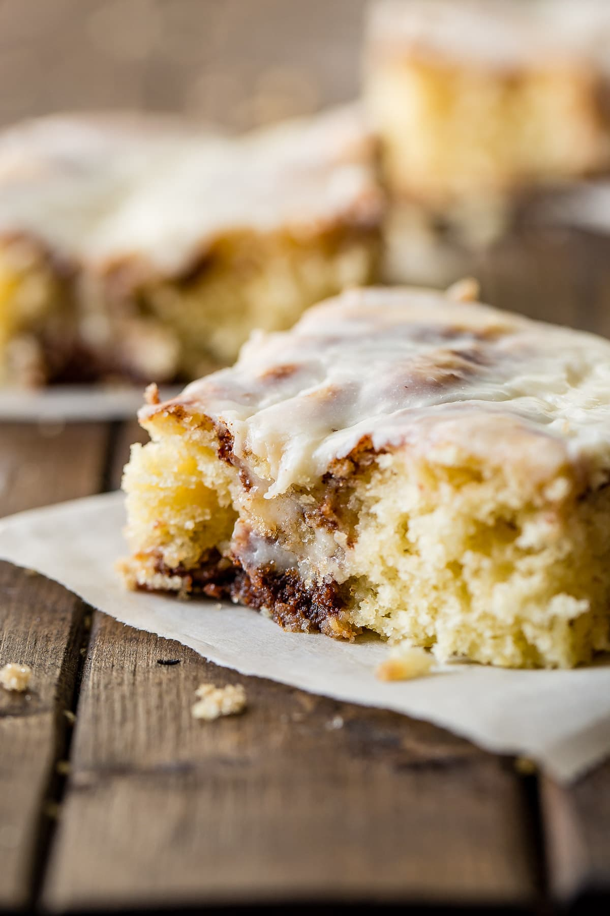 It's happening!! I love sheet cakes! This Cinnabon cinnamon roll sheet cake is one of my newest obsessions. Plus, Cooked Vanilla Cream Cheese Frosting! ohsweetbasil.com