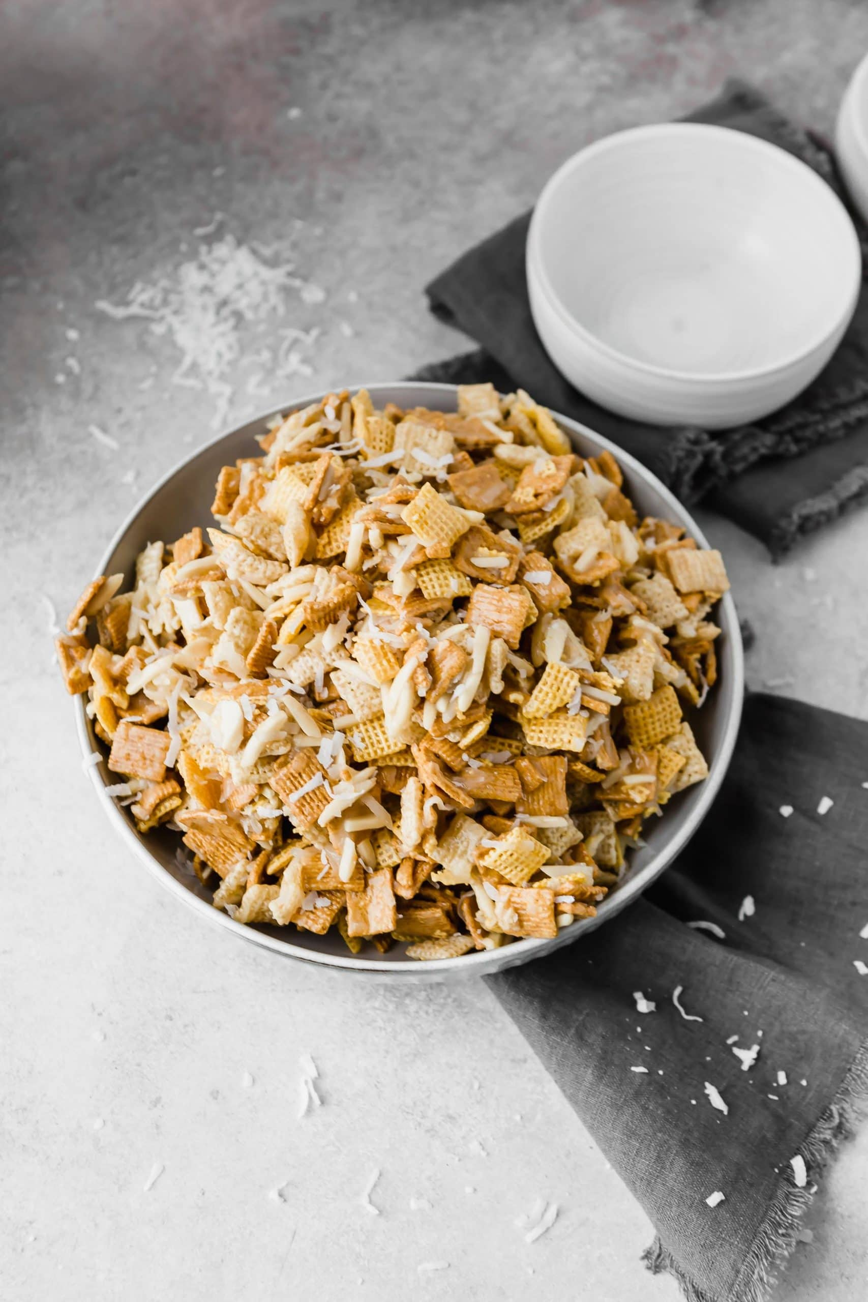 A picture of a large bowl filled with coconut sweet chex mix.
