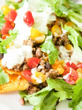 This is not as crazy as it seems. Doritos taco salad is not your typical #tacotuesday meal as there are chips other than corn involved, but just trust me. ohsweetbasil.com