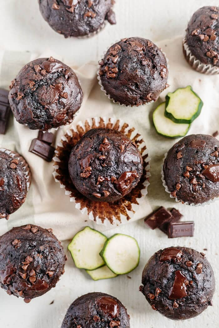 overhead view of many zucchini double chocolate chip muffins