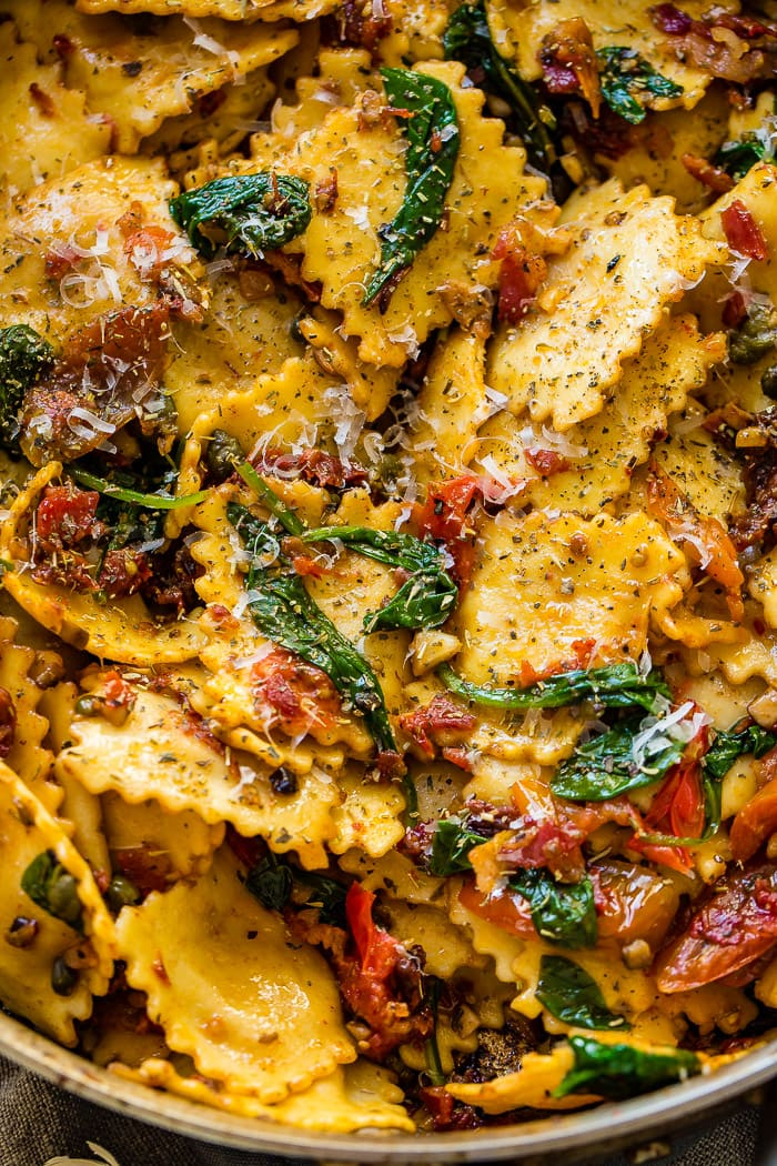 a skillet with easy crispy pancetta with sun dried tomatoes and spinach