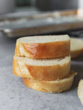 a photo of three slices of french bread stacked on top of each other.