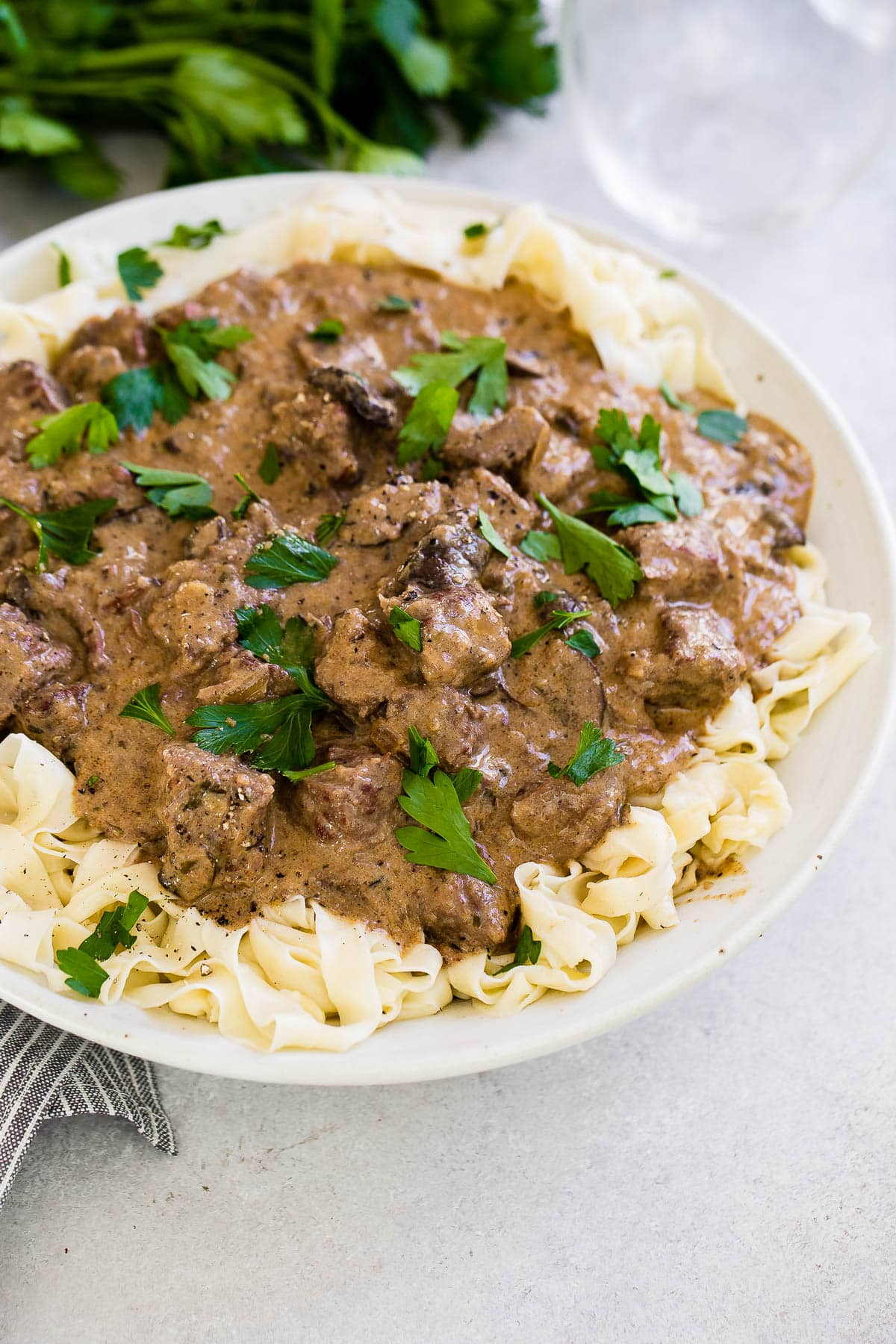 bowl of noodles topped with instant pot beef stroganoff