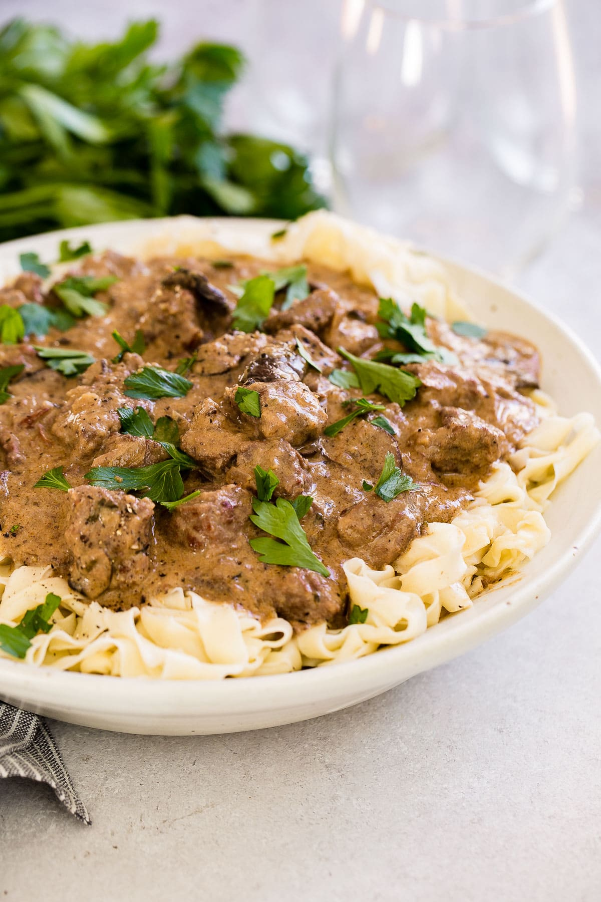 bowl of pasta topped with instant pot stroganoff