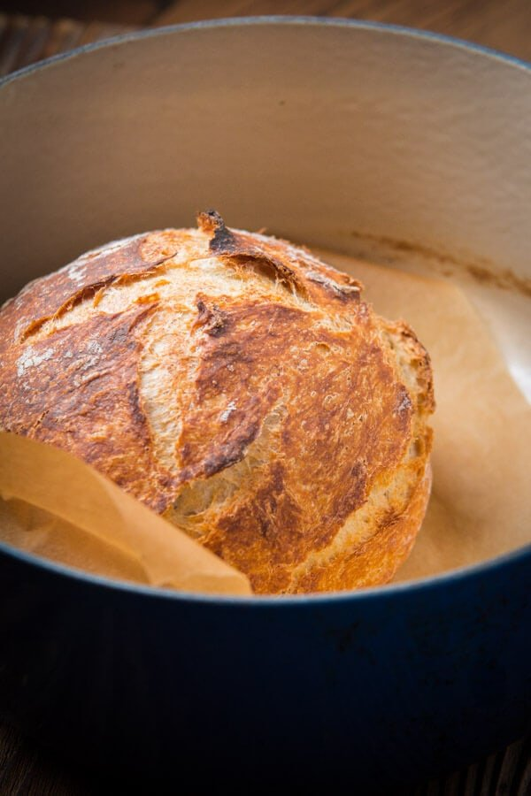 loaf of No-Knead Artisan Bread in blue dutch oven
