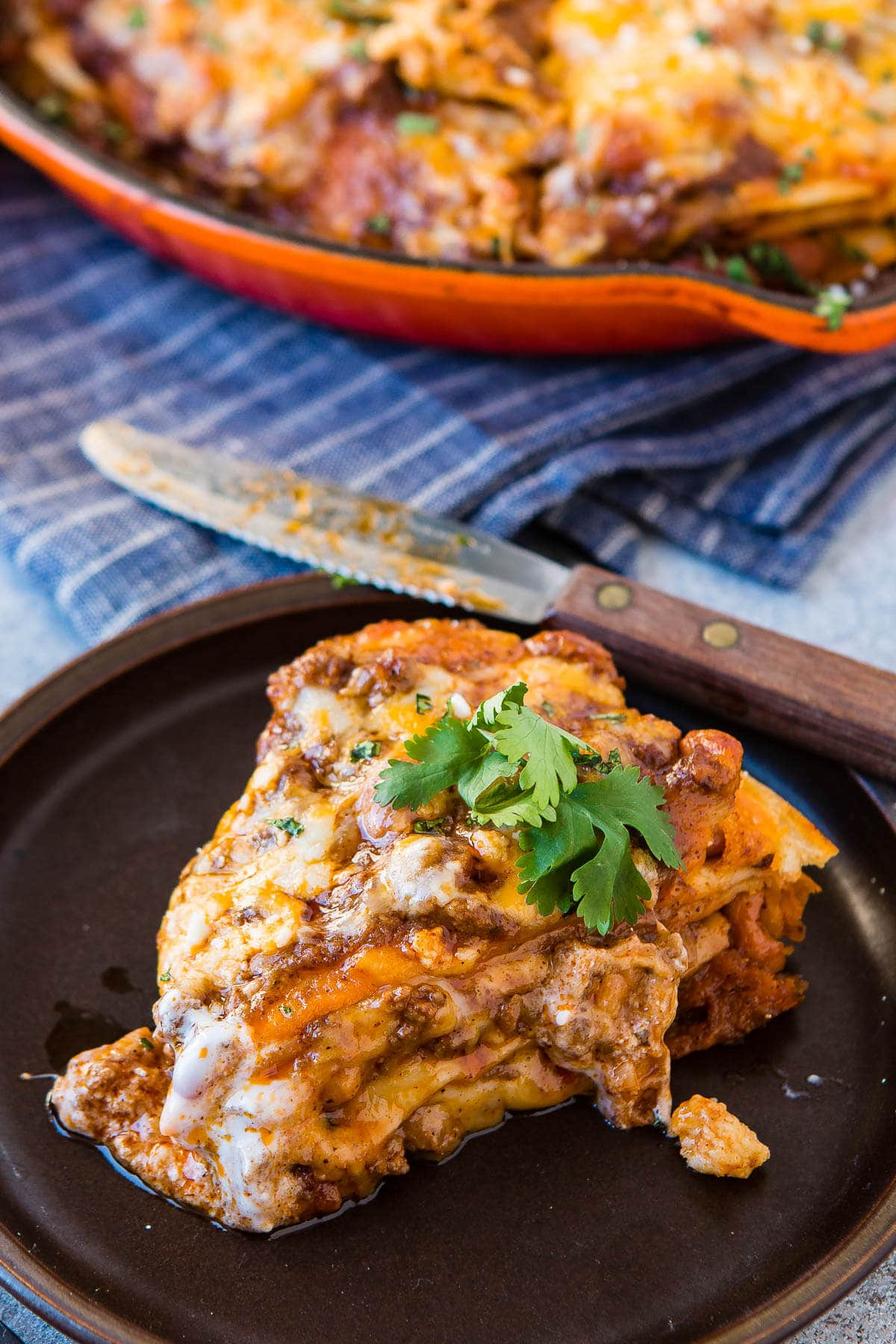 Looking for a recipe with ground beef? This one skillet enchilada tortilla stack is our all time favorite! ohsweetbasil.com
