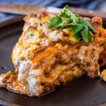 This is so good!!! One skillet enchilada casserole is loaded with saucy ground beef, gooey cheese and lots of flavor! It's our family's new favorite easy dinner recipe! ohsweetbasil.com