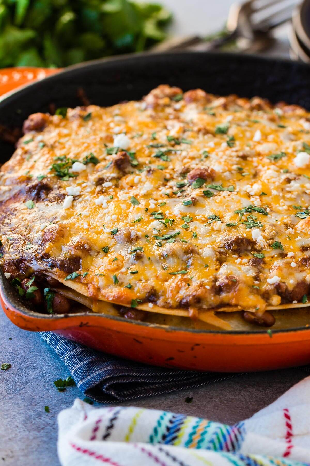 Nothing is better than a skillet piled high with saucy meat, flour tortillas and gooey cheese. One skillet enchilada casserole is perfect for family dinner. ohsweetbasil.com