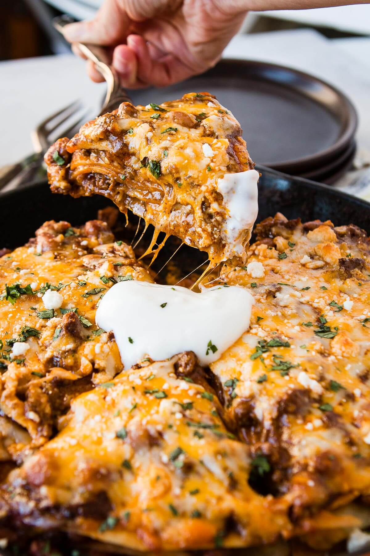 Looking for an easy enchiladas recipe? This one skillet enchilada casserole has everything you love about enchiladas without all the time it takes to roll them! ohsweetbasil.com