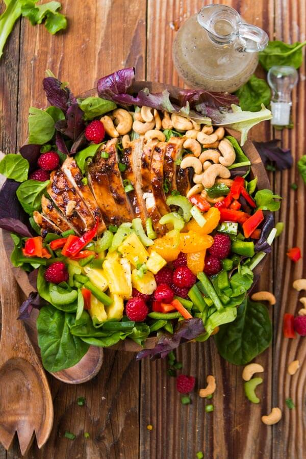 Throw together a simple salad of mixed greens, teriyaki chicken and fresh fruits and top it off with dressing! ohsweetbasil.com