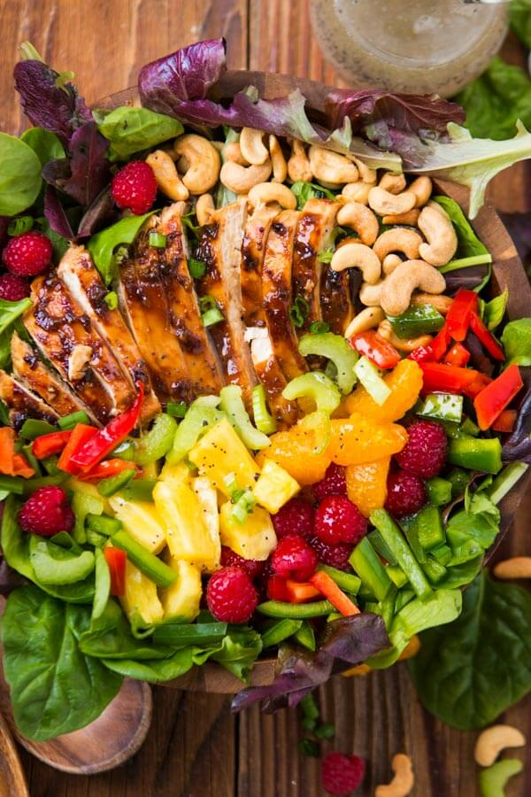 Our most favorite salad, teriyaki chicken salad!! It's so easy and perfect for all summer long! Juicy chicken, veggies, fruit and crunchy cashews! ohsweetbasil.com