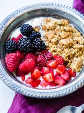 fruit and granola yogurt protein bowl, with berries and granola