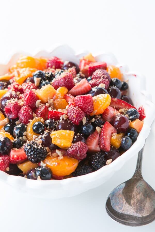 The perfect side dish for bbqs, and potlucks or a warm summer day, fruit salad with lemon dressing and yummy brown sugar nuts! grain-free