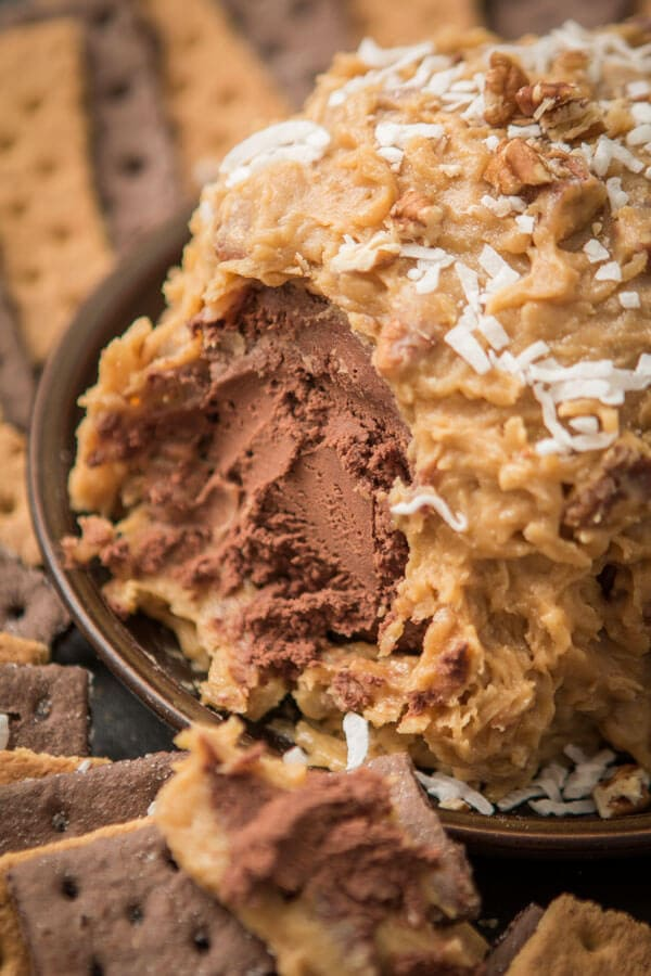 Love German chocolate cake? Especially that sticky coconut frosting? This German Chocolate Cake Cheese Ball is way easier than cake but just as delicious! ohsweetbasil.com