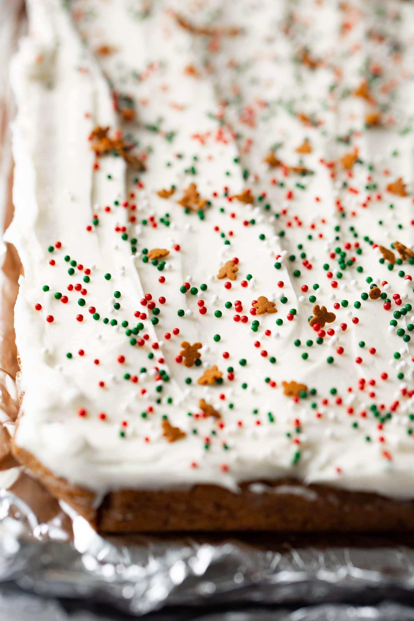 A photo of a pan of frosted gingerbread bars before being cut.