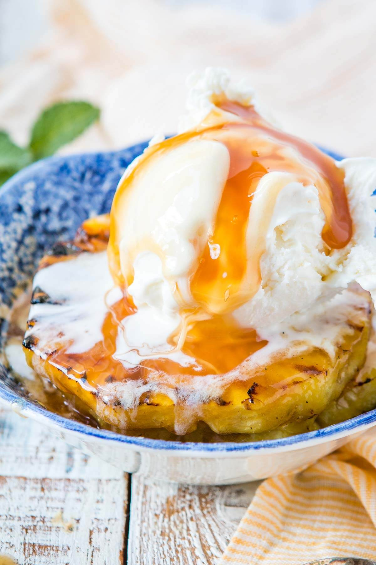SWEET. MERCY. This brown sugar grilled pineapple sundaes recipe is the best way to use pineapple during the summer. Sundae of the year!