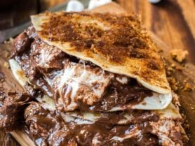 Want to know what the number one dessert of the summer is? It's not pie, it's grilled s'mores dessert quesadillas stuffed with nutella and marshmallows! ohsweetbasil.com