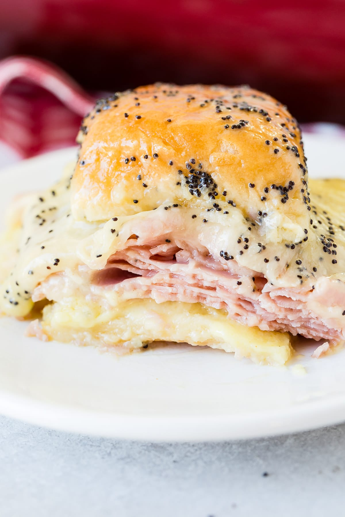 Ham and cheese sliders with poppy seed dressing is the best recipe for leftover ham! ohsweetbasil.com