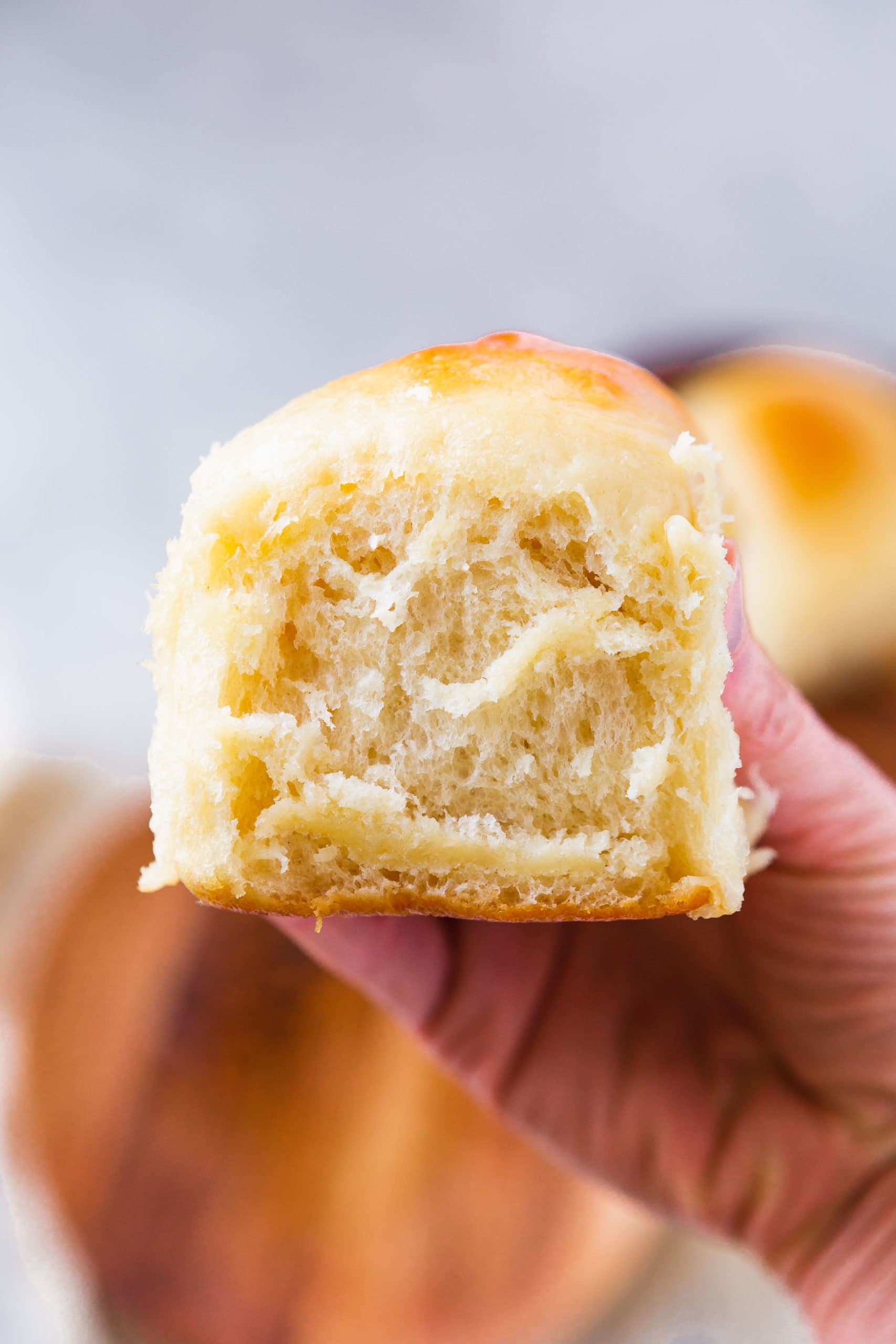 Picture of a person holding a Hawaiian fluffy roll.