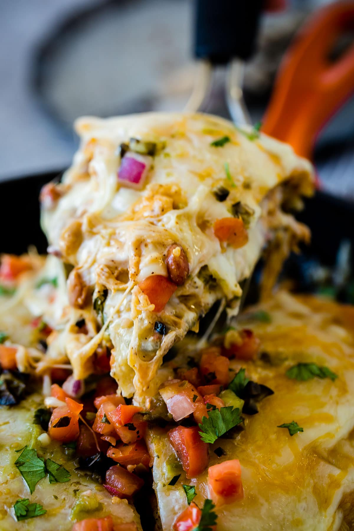 Loved our One Skillet Enchilada Casserole? Us too. That's why today we are bringing you a lighter One Skillet Honey Lime Chicken Enchiladas Casserole.