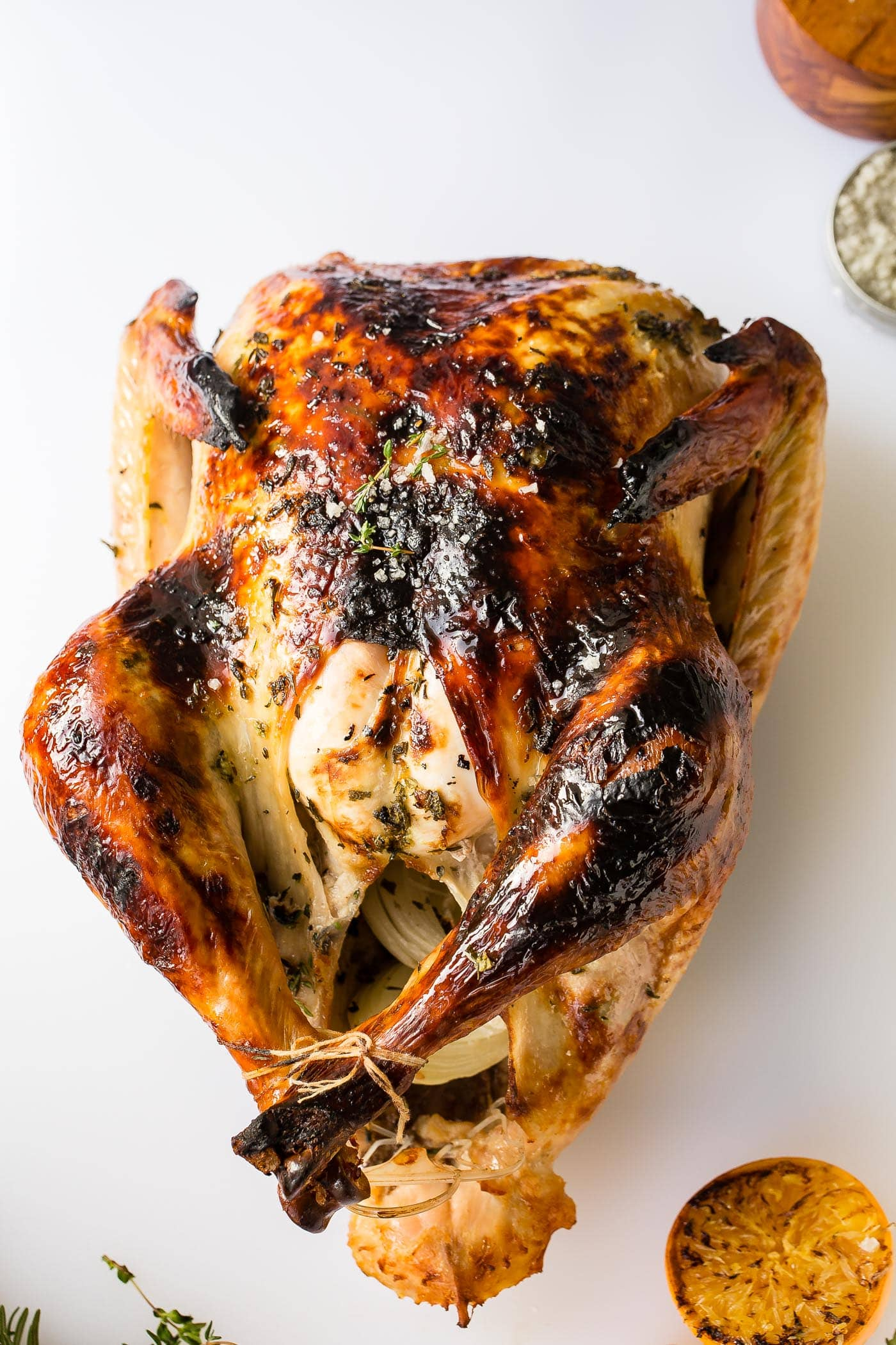 A roasted whole turkey that is ready to be carved.