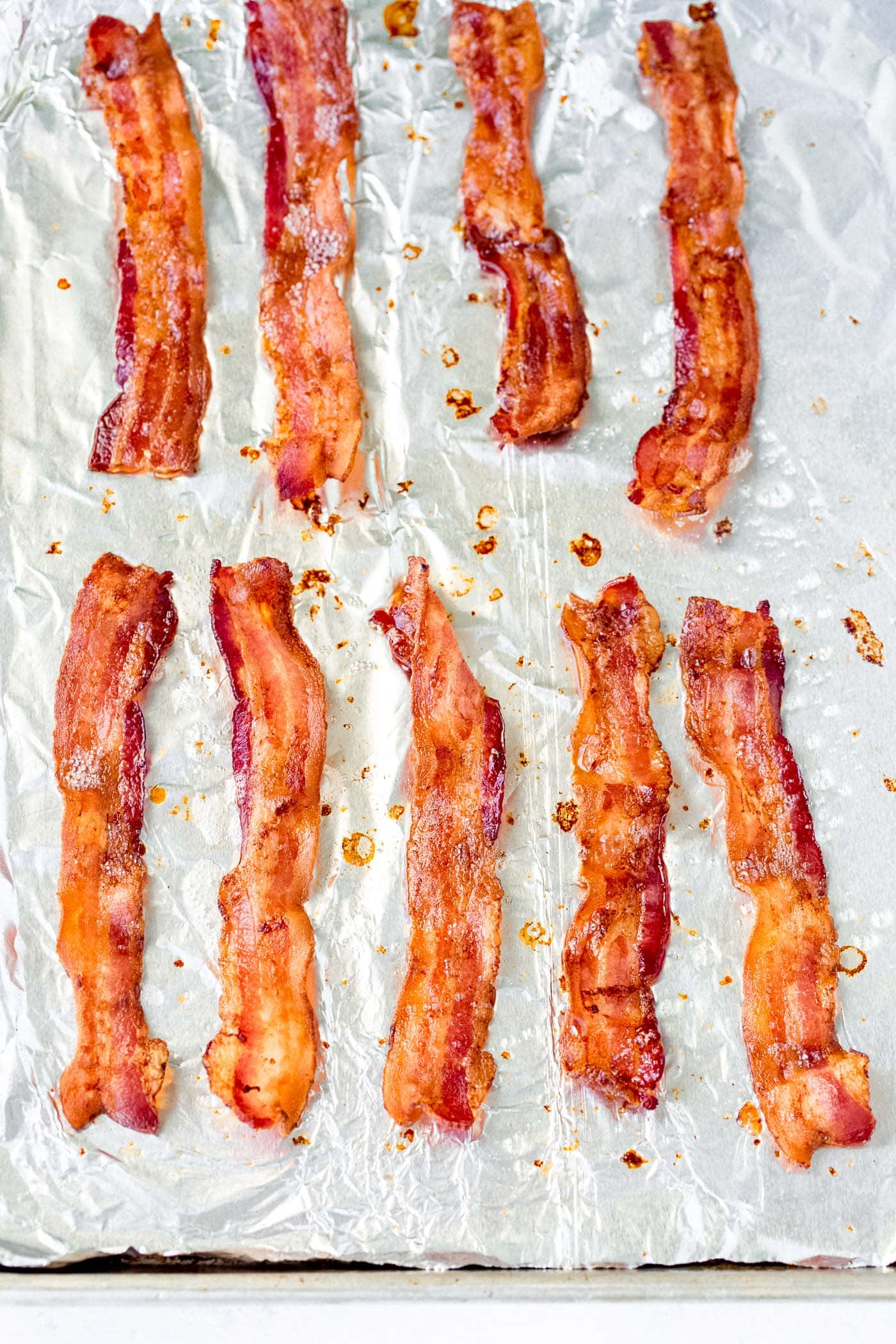 Perfectly crisp bacon on a baking tray lined with foil.