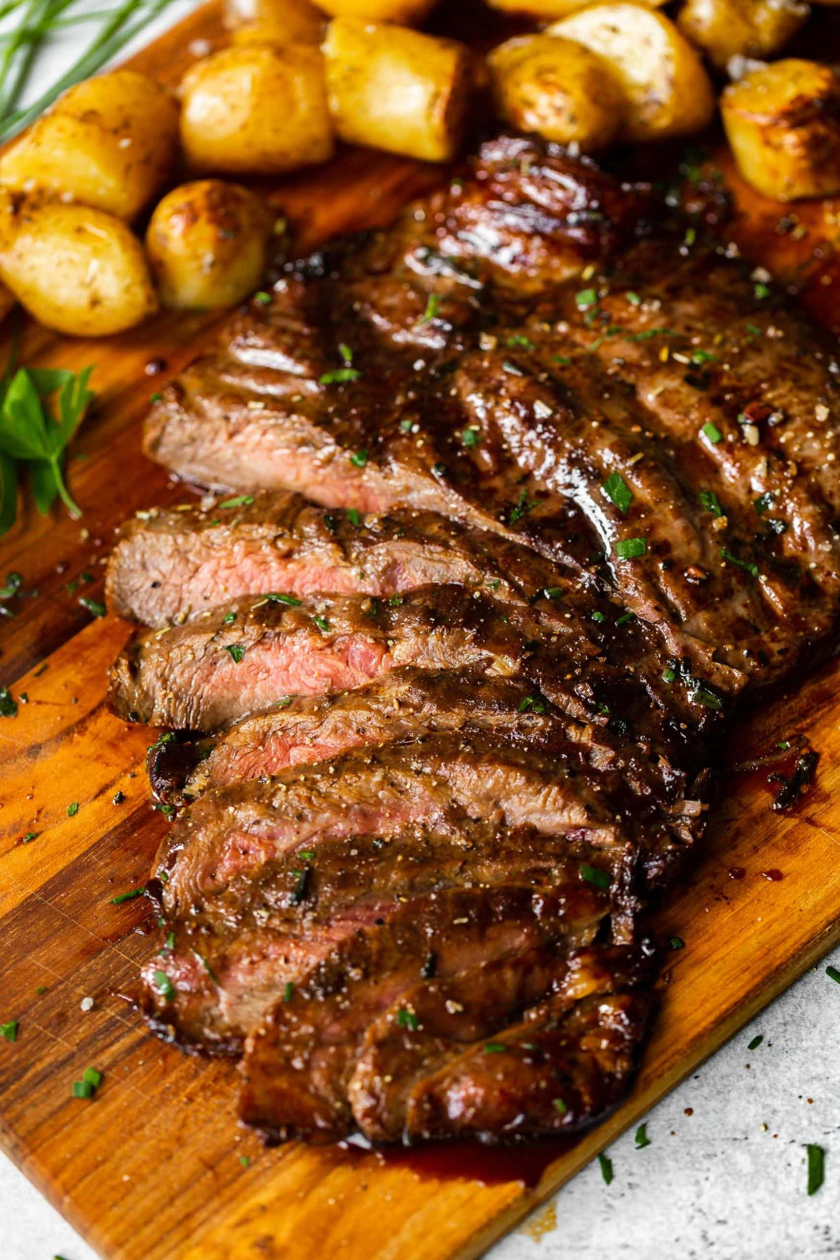 a sliced flank steak that has been cooked on a gas grill with a balsamic soy sauce marinade