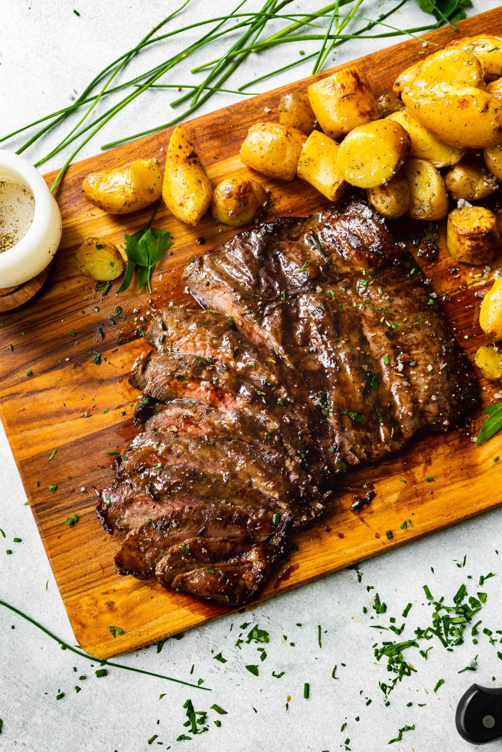 roasted yukon gold potatoes with a grilled flank steak sliced thinly