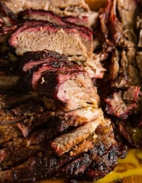 A photo of perfectly smoked beef brisket sliced and ready to devour.