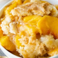a bowl of instant pot peach cobbler with cake mix