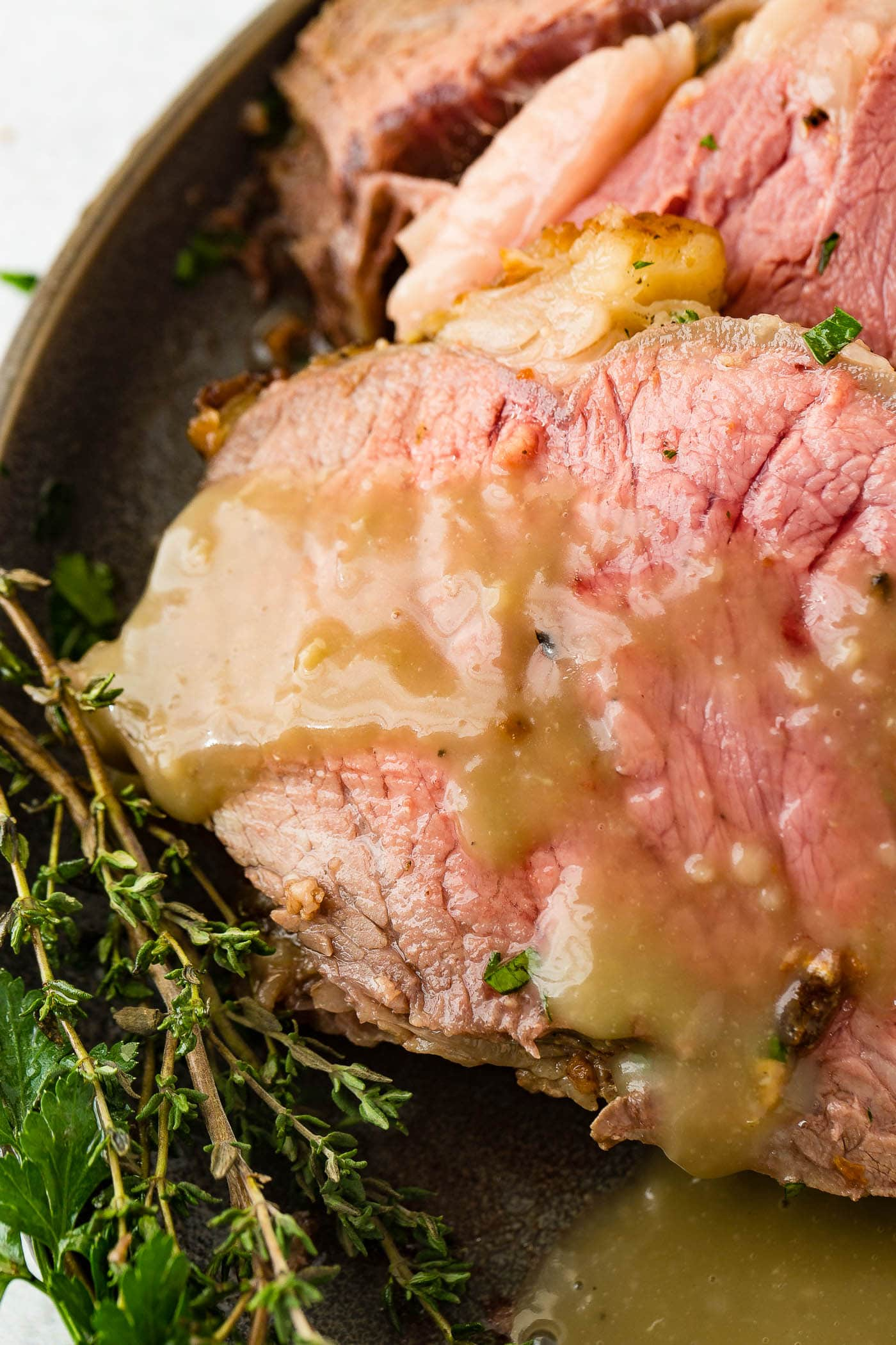 A photo of a slice of instant pot prime rib covered in delicious gravy.