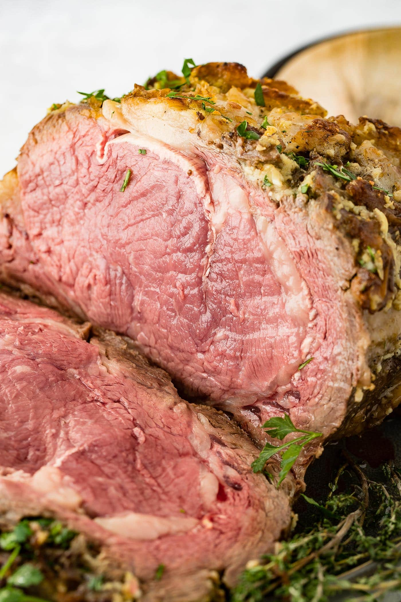 A photo of cooked instant pot prime rib sliced into.