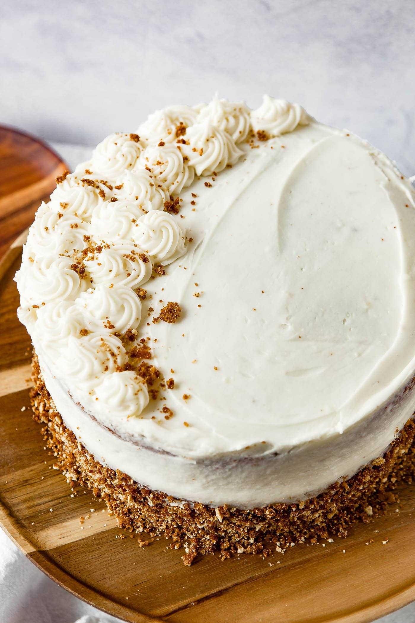 Top view of a two layer spice cake that is frosted with cream cheese frosting.