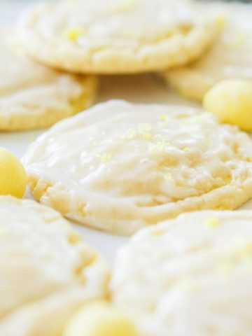 Soft and chewy lemon drop cookies are the perfect treat for those lemon lovers out there! A light glaze on top and a sprinkle of crushed lemon drops! ohsweetbasil.com