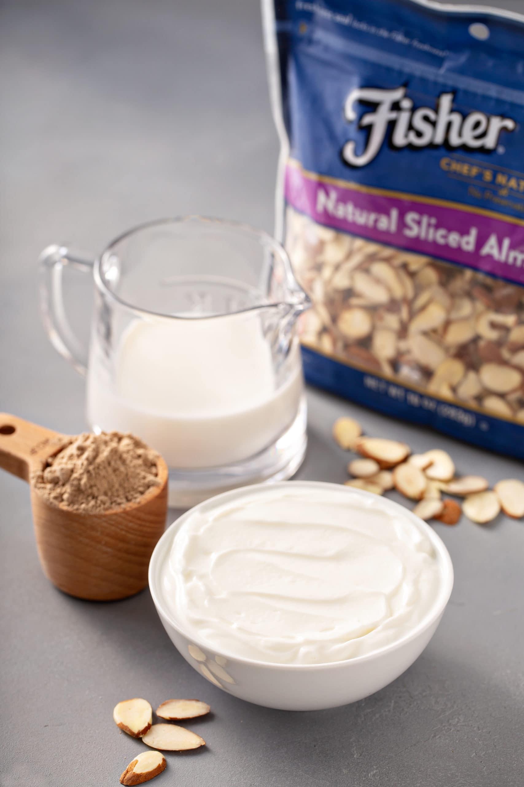 ingredients to make an almond joy protein shake like yogurt, milk, chocolate protein, almonds