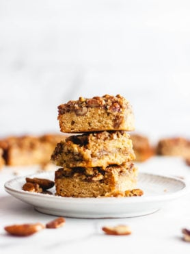 Maple pecan pie bars stacked on top of each other