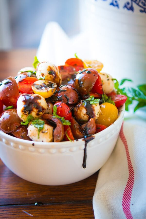 This easy tomato mozzarella salad is so refreshing and perfect for a spring or summer side dish, plus you can make it a few different ways! gluten-free
