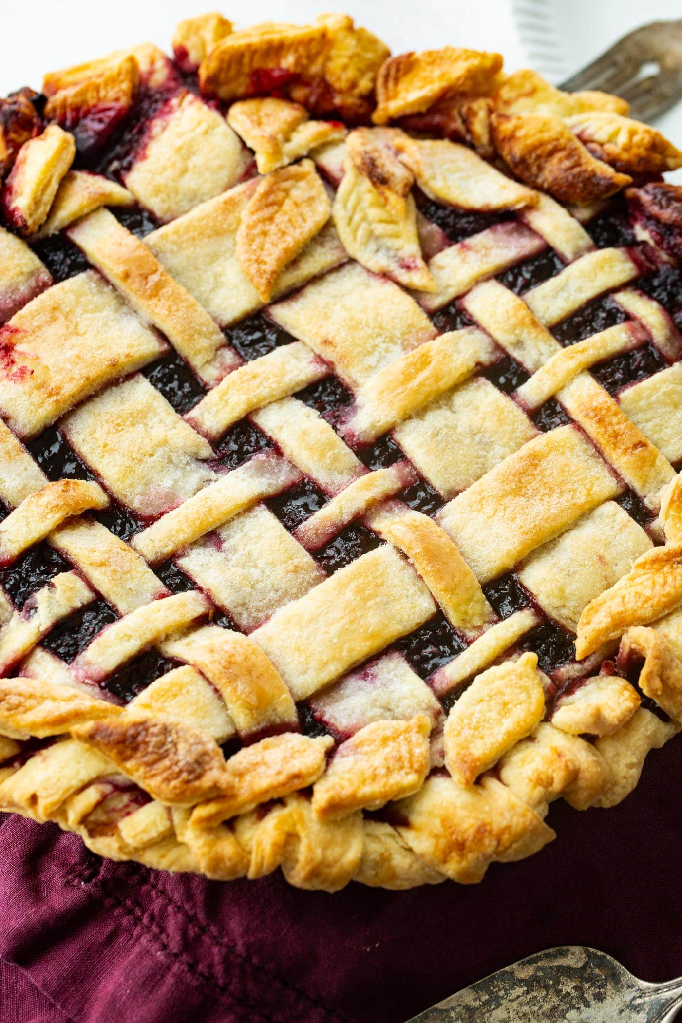 a lattice topped blackberry marionberry pie