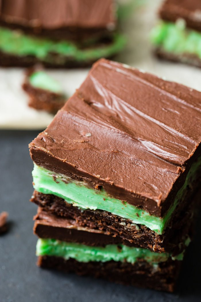 A black board with brownies with a mint frosting and a chocolate ganache over the top. Our copycat byu mint brownies from scratch