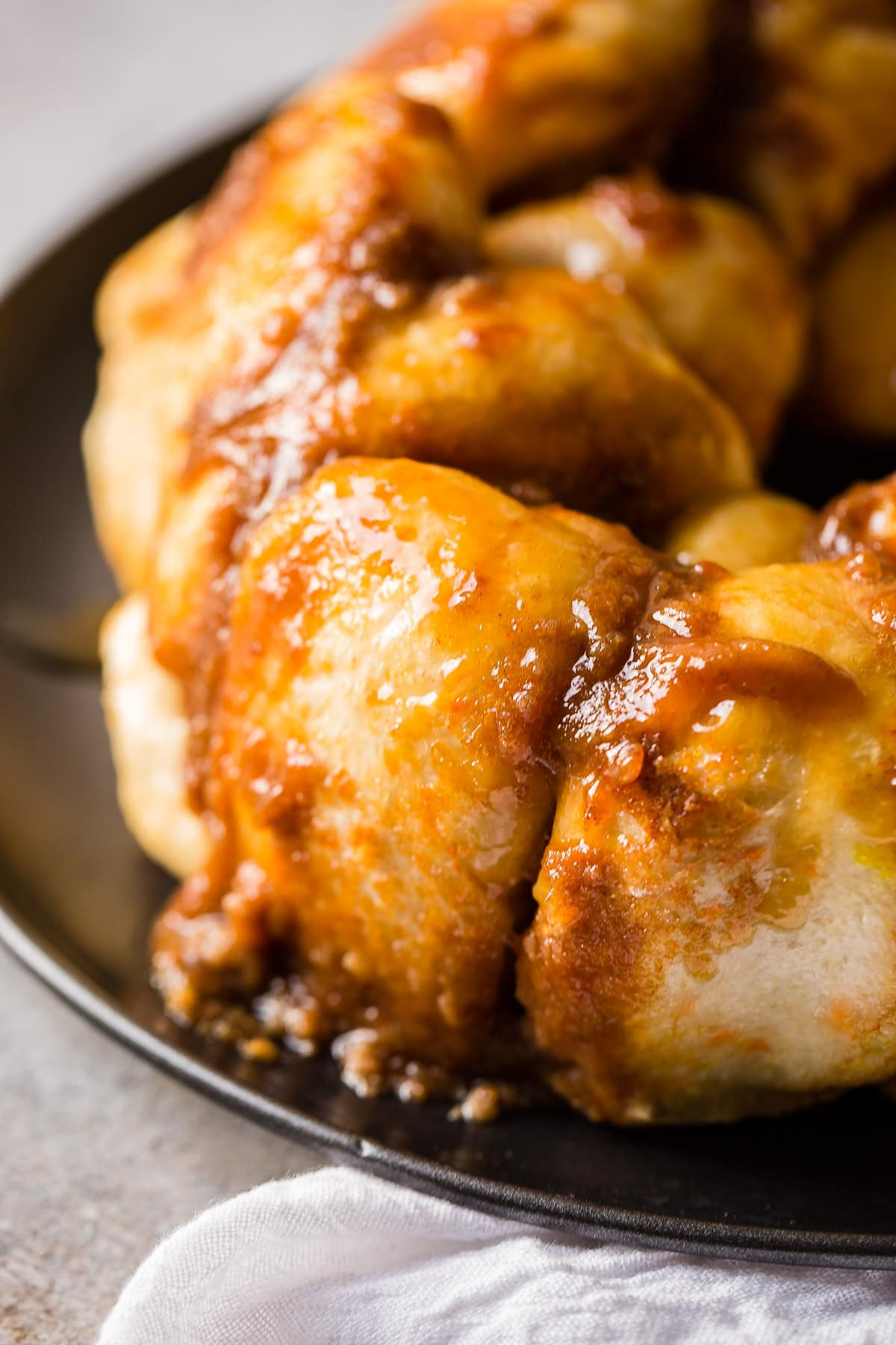 We have had this monkey bread my whole life! Just 4 ingredients and they are so soft and light. Seriously delicious! My mom's sticky buns are amazing!