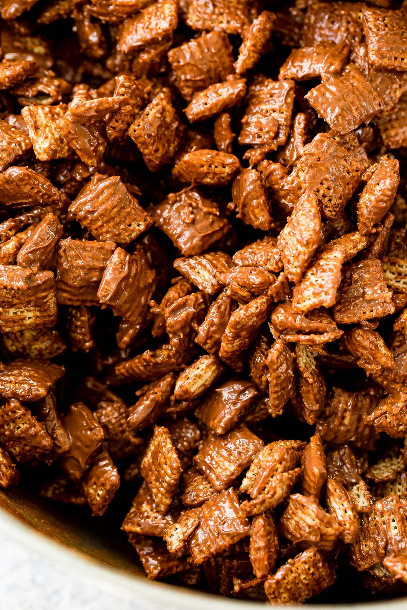 A photo of rice Chex coated in melted chocolate and peanut butter.
