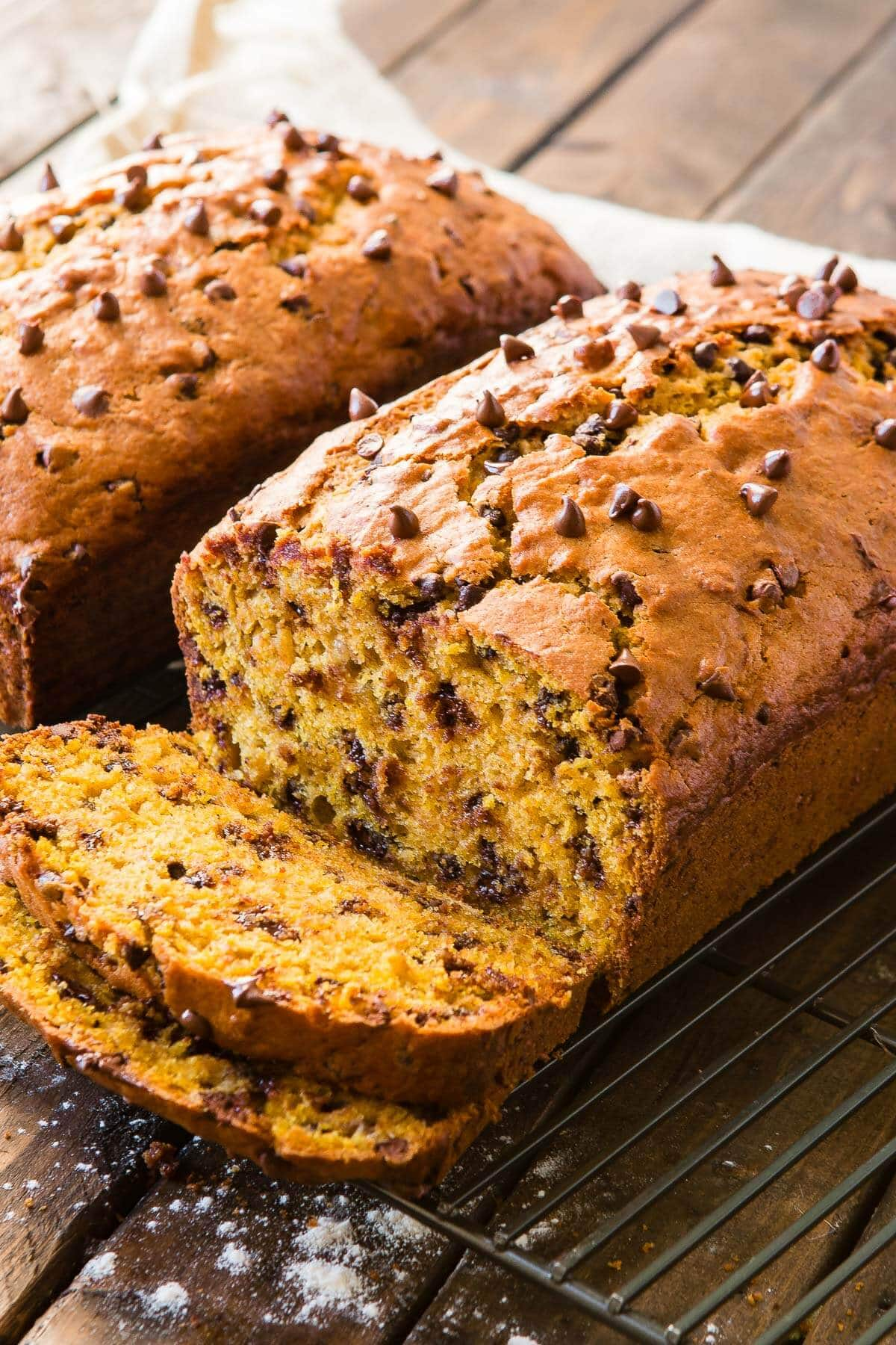 Soft pumpkin banana bread with mini chocolate chips and it smells like fall the minute you stick it in the oven! ohsweetbasil.com