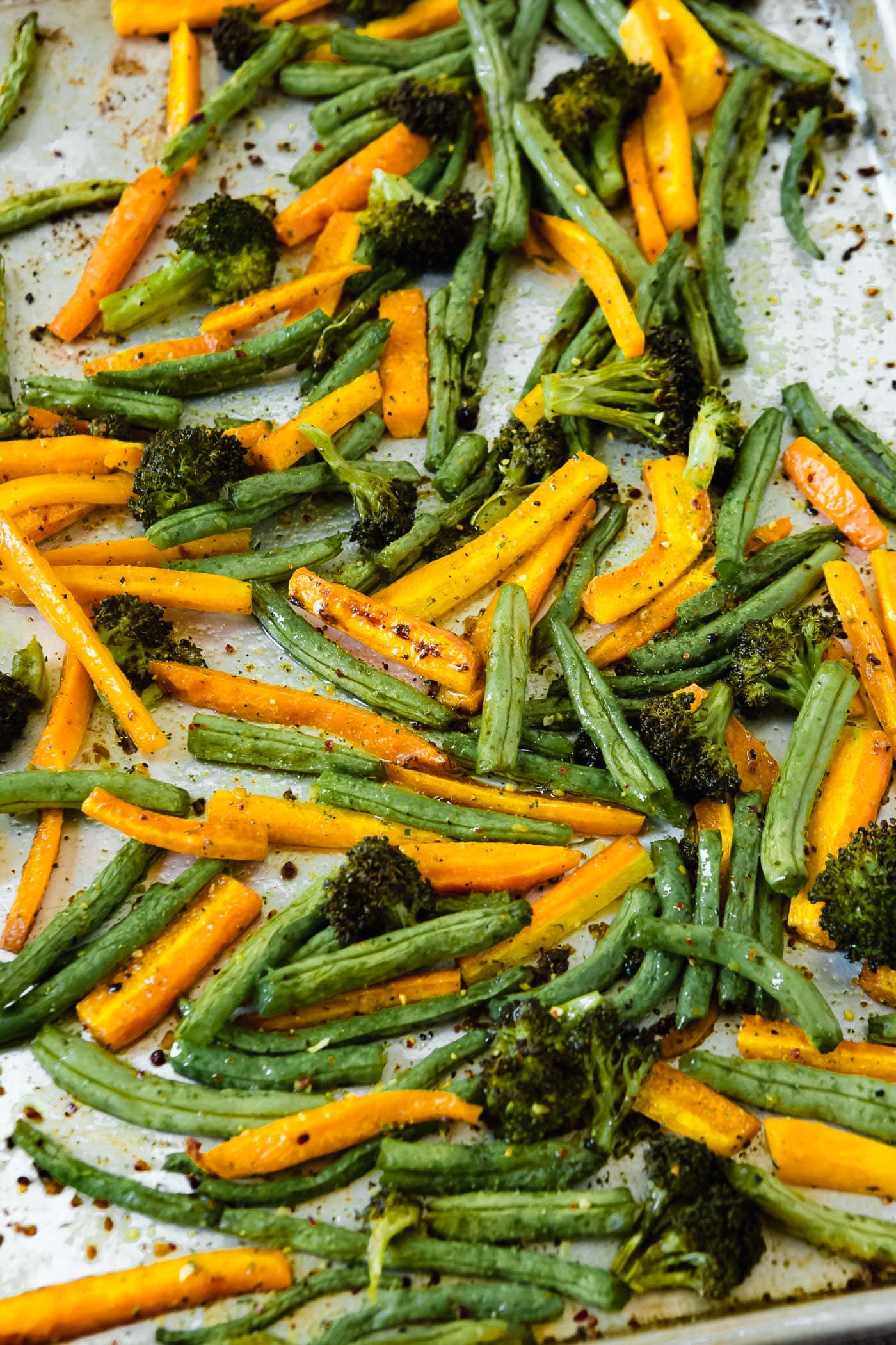 a photo of a roasted vegetable medley on a baking sheet