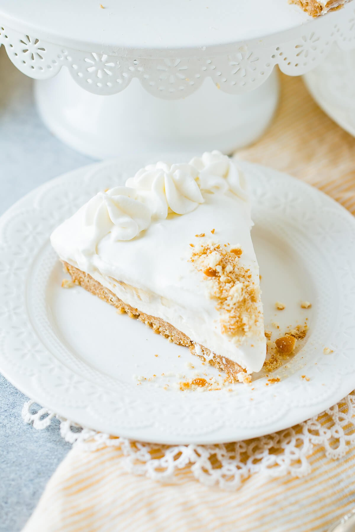 slice of no bake banana pudding cheesecake on white plate